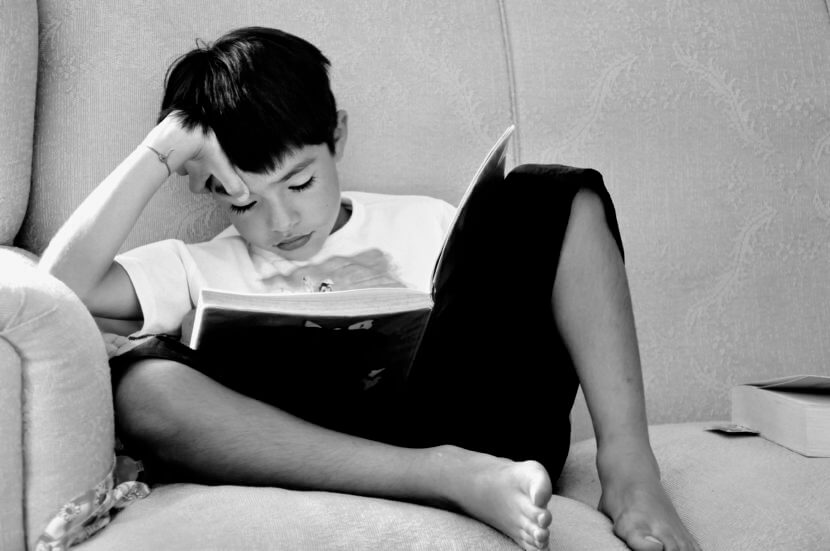 School Boy Reading at Home