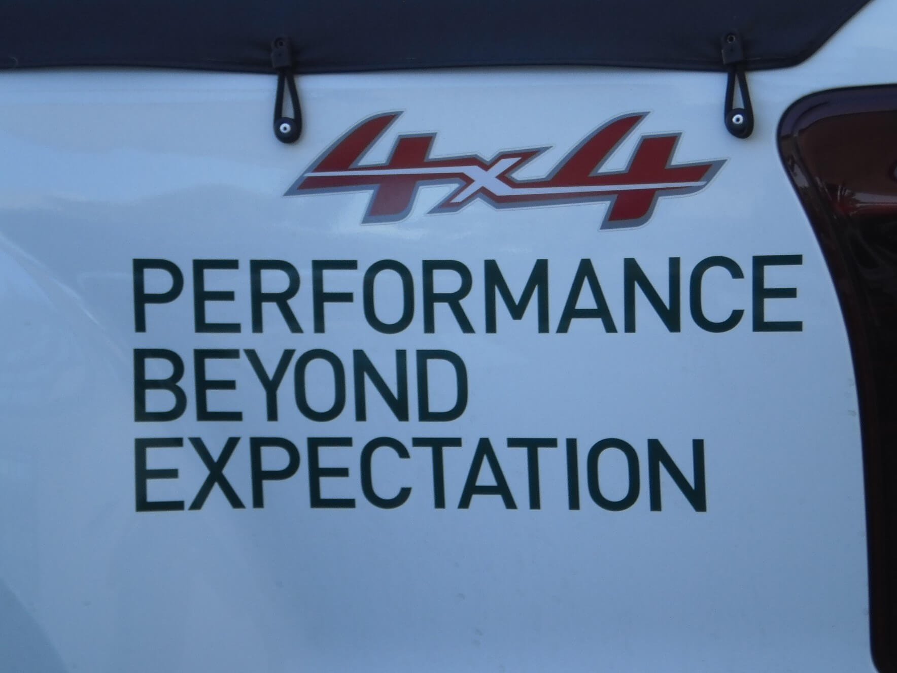 Slogan on 4WD ute - Performance beyond expectation