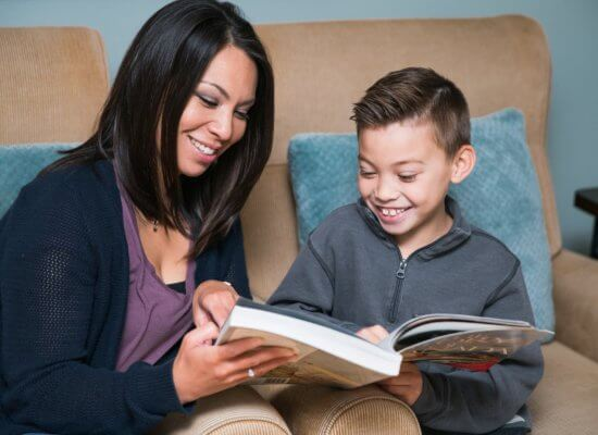 Mother and Son Reading a Funny Book